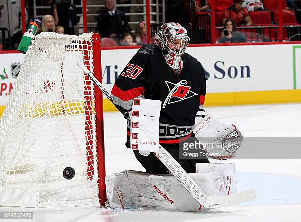 Cam Ward of the Carolina Hurricanes goes down in the crease and keeps his eye on the puck during an NHL game against the Winnipeg Jets on November 20...