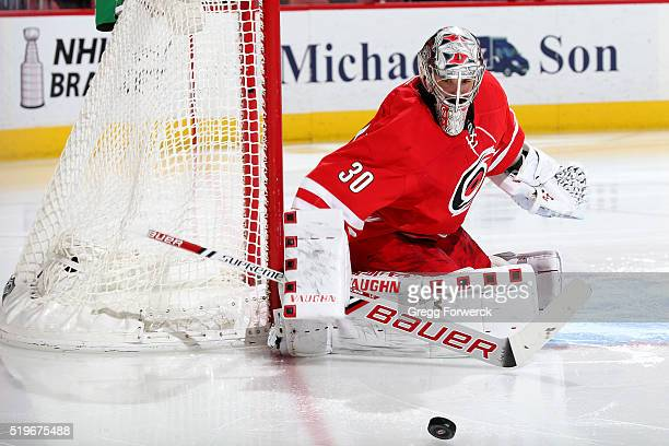 Cam Ward of the Carolina Hurricanes goes down in the crease and deflects the puck during an NHL game against the Montreal Canadiens at PNC Arena on...