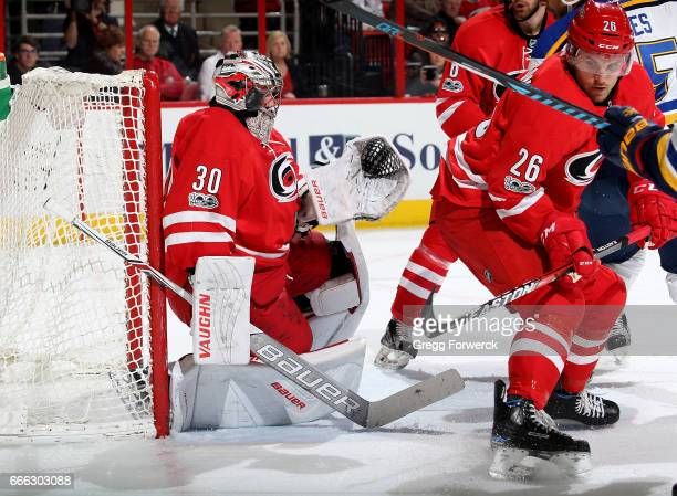 Cam Ward of the Carolina Hurricanes goes down in the crease to make a save during an NHL game against the St Louis Blues on April 8 2017 at PNC Arena...