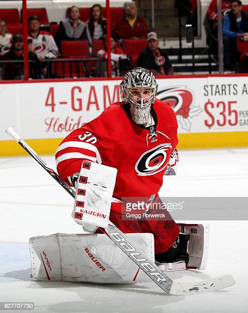 Cam Ward of the Carolina Hurricanes keep his eye on the puck as he deflects it away from the net during an NHL game against the Tampa Bay Lightning...