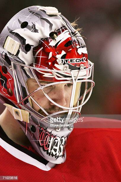 Cam Ward of the Carolina Hurricanes looks on against the New Jersey Devils in game one of the Eastern Conference Semifinals during the 2006 NHL...