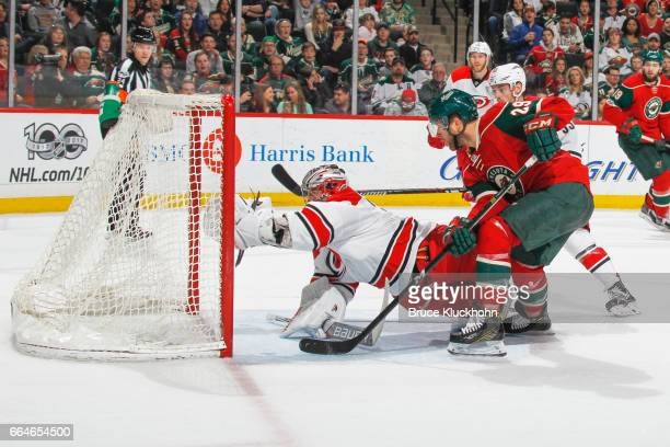 Cam Ward of the Carolina Hurricanes makes a diving save against Jason Pominville of the Minnesota Wild during the game on April 4 2017 at the Xcel...
