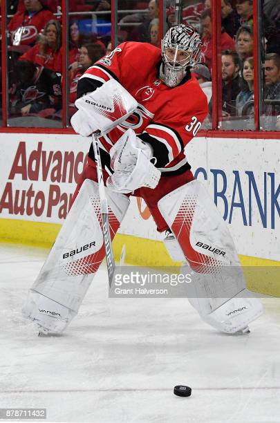 Cam Ward of the Carolina Hurricanes makes a pass during their game against the Toronto Maple Leafs at PNC Arena on November 24 2017 in Raleigh North...