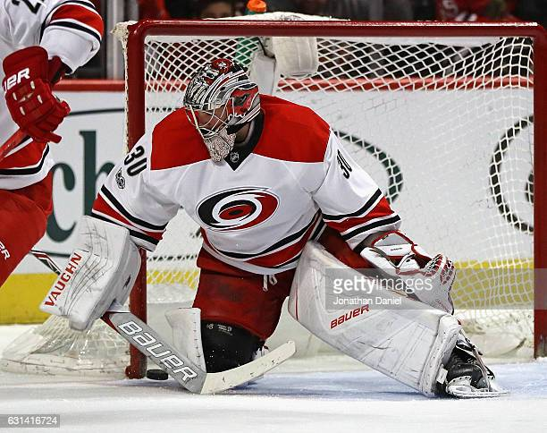 Cam Ward of the Carolina Hurricanes makes a save against the Chicago Blackhawks at the United Center on January 6 2017 in Chicago Illinois The...
