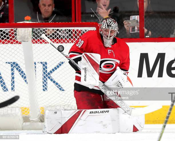 Cam Ward of the Carolina Hurricanes makes a save during an NHL game against the Boston Bruins on March 13 2018 at PNC Arena in Raleigh North Carolina