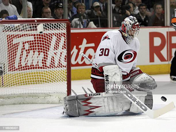 Cam Ward of the Carolina Hurricanes makes a save during game 3 of the Eastern Conference Finals versus the Buffalo Sabres at the HSBC Arena in...