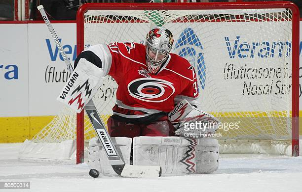 Cam Ward of the Carolina Hurricanes makes a save during their NHL game against the Atlanta Thrashers on March 28 2008 at RBC Center in Raleigh North...