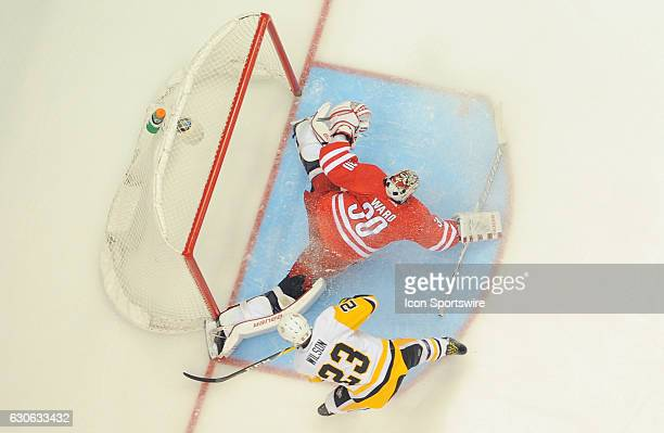 Cam Ward of the Carolina Hurricanes makes a save on a breakaway attempt by Scott Wilson of the Pittsburgh Penguins in the second period during the...
