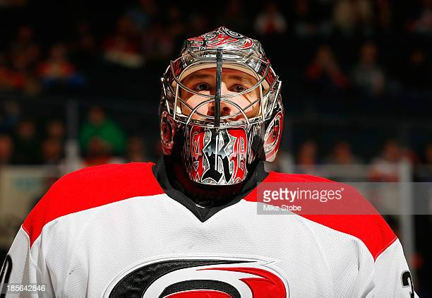 Cam Ward of the Carolina Hurricanes skates against the New York Islanders at Nassau Veterans Memorial Coliseum on October 19 2013 in Uniondale New...