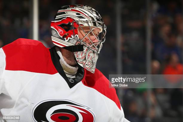 Cam Ward of the Carolina Hurricanes skates against the New York Islanders skates against the Carolina Hurricanes at the Barclays Center on March 13...