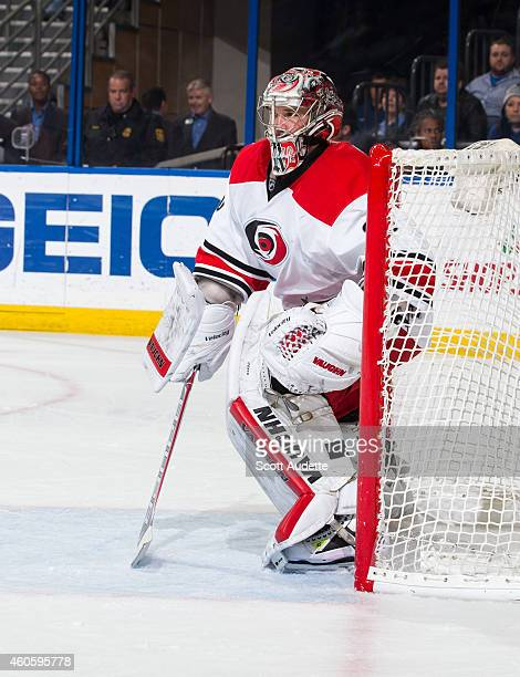 Cam Ward of the Carolina Hurricanes skates against the Tampa Bay Lightning at the Amalie Arena on December 11 2014 in Tampa Florida