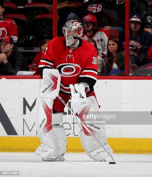 Cam Ward of the Carolina Hurricanes skates out of the crease to play the puck during an NHL game against the Washington Capitals on January 2 2018 at...