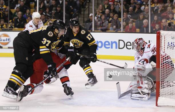 Cam Ward of the Carolina Hurricanes stops a shot by Patrice Bergeron of the Boston Bruins on November 26 2010 at the TD Garden in Boston...