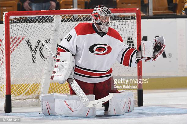 Cam Ward of the Carolina Hurricanes warms up before the game against the Boston Bruins at the TD Garden on December 1 2016 in Boston Massachusetts