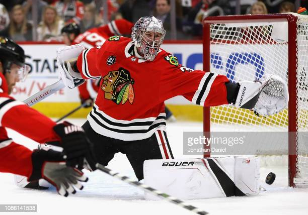 Cam Ward of the Chicago Blackhawks makes a save against the Florida Panthers at the United Center on December 23 2018 in Chicago Illinois