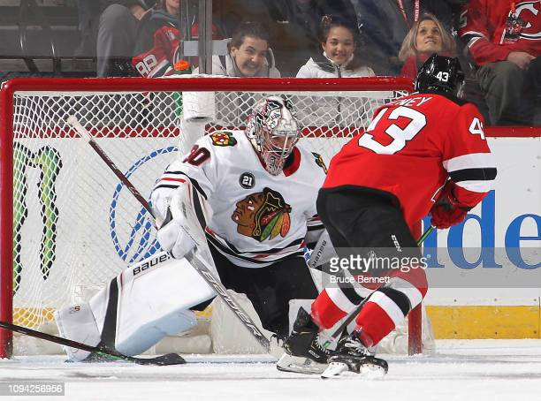Cam Ward of the Chicago Blackhawks makes the first period save on Brett Seney of the New Jersey Devils at the Prudential Center on January 14 2019 in...