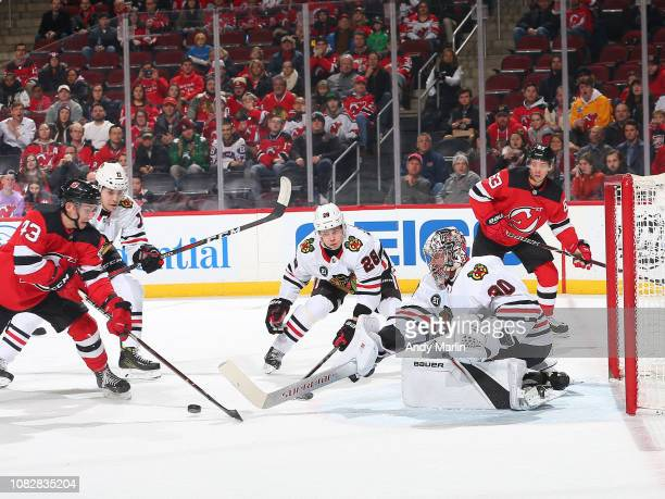 Cam Ward of the Chicago Blackhawks stops a shot on goal by Brett Seney of the New Jersey Devils during the first period at the Prudential Center on...
