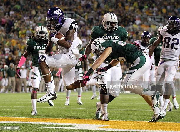 Cam White of the Texas Christian University Horned Frogs runs for a 2nd quarter touchdown against Ahmad Dixon and Sam Holl of the Baylor University...