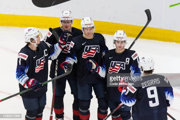 Cam York, Arthur Kaliyev, Matthew Boldy, Cole CAUFIELD and Trevor Zegras of the United States celebrate a goal against Austria during the 2021 IIHF...
