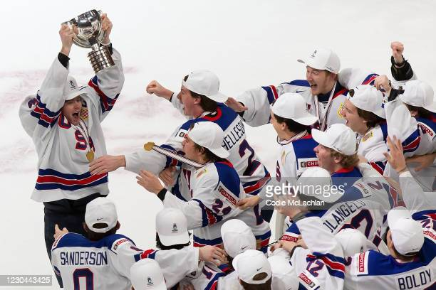Cam York of the United States hoists the World Junior Championship trophy after beating Canada during the 2021 IIHF World Junior Championship gold...