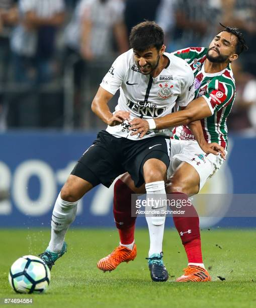 Camacho of Corinthians and Henrique Dourado of Fluminense in action during the match between Corinthians and Fluminense for the Brasileirao Series A...