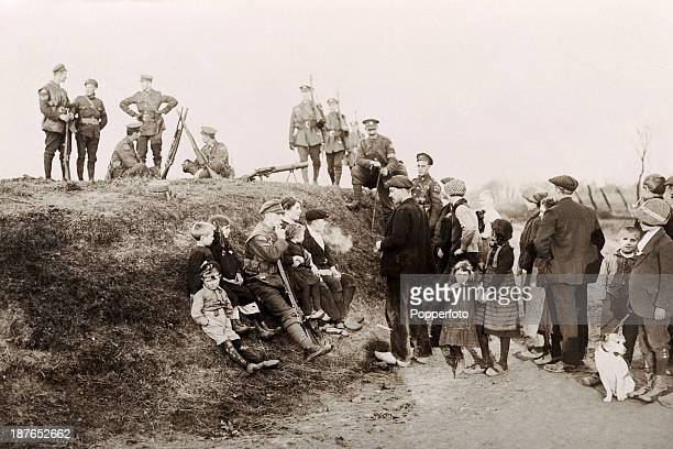 Camaraderie between Belgians and Canadian soldiers outside Mons at the conclusion of World War One 11th November 1918