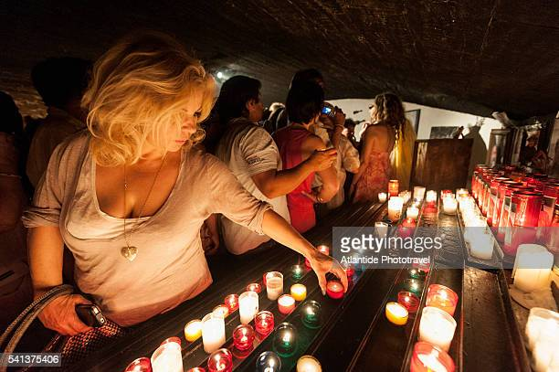 Camargue - Gypsy Pilgrimage, worshippers in the in the crypt of the Church of Saintes Maries de la Mer praying St. Sarah (or St. Sara), Patron Saint of the Gypsies