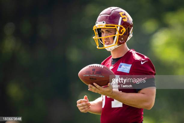 Camaron Cheeseman of the Washington Football Team participates in a drill during mandatory minicamp at Inova Sports Performance Center on June 10,...