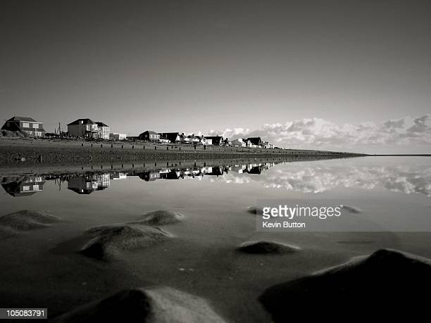 camber sands reflection in black and white - camber sands stock photos and pictures