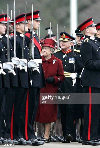 Britain's Queen Elizabeth II passes her grandson Prince William as she inspects graduates at the The Royal Military Academy in Camberley 35 miles...