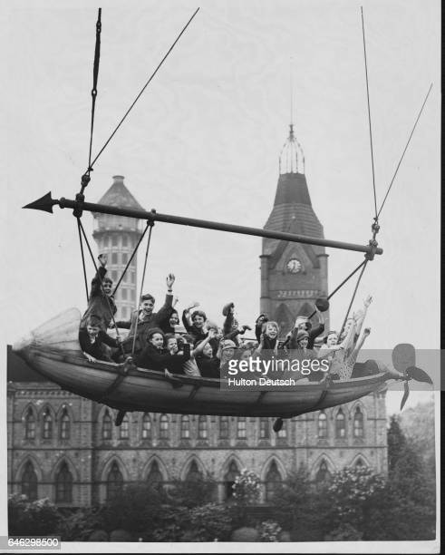 Camberwell schoolchildren wave from a swing ship as it rotates above the grounds of Crystal Palace The ride is one of a number of amusements...