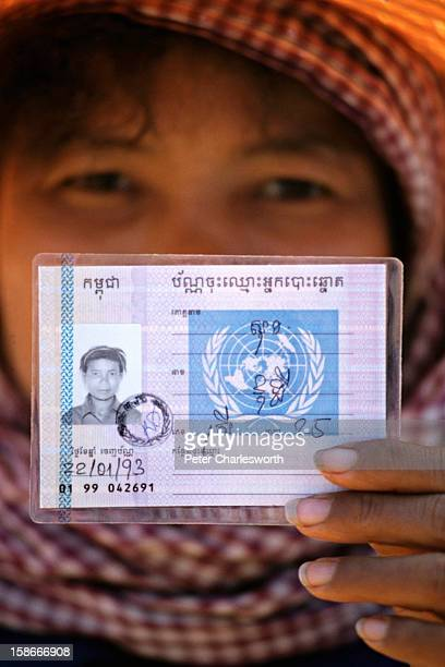 A Cambodian woman who has been repatriated from a refugee camp in Thailand holds her election card Identification that has been issued by UNTAC