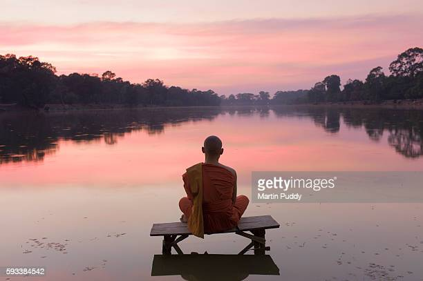 Cambodia, Angkor Wat, Buddhist Monk at sunset
