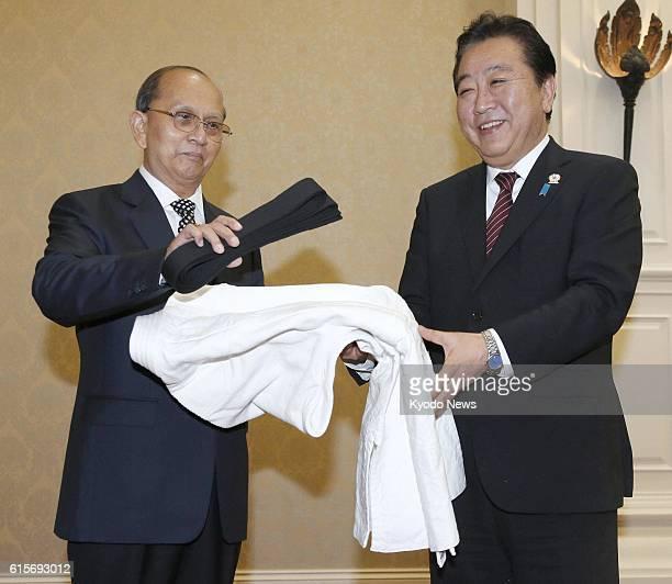 Cambodia - Japanese Prime Minister Yoshihiko Noda presents a judo uniform and black belt as a gift to Myanmar President Thein Sein prior to their...