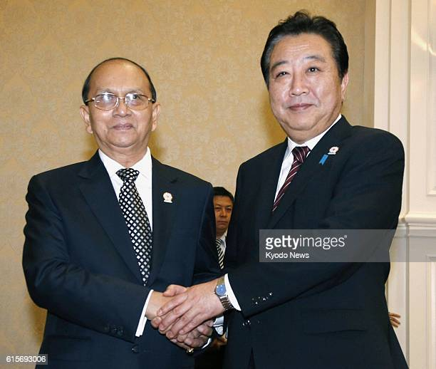 Cambodia - Japanese Prime Minister Yoshihiko Noda shakes hands with Myanmar President Thein Sein prior to their talks in Phnom Penh, Cambodia, on...
