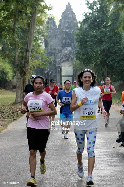 REAP Cambodia Japanese twotime Olympic women's marathon medalist Yuko Arimori runs in an international half marathon at the Angkor Watt relics in...