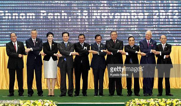 Cambodia - Leaders join hands at the summit meeting of the Association of Southeast Asian Nations in Phnom Penh on Nov. 18, 2012. Shown are...