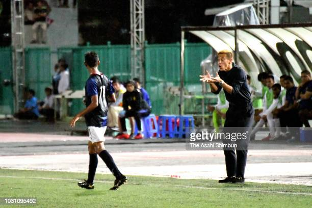 Cambodia national team general manager Keisuke Honda instructs players during the international friendly match between Cambodia and Malaysia on...