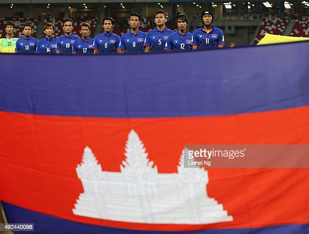 Cambodia national team line up for their national anthem during the FIFA 2018 World Cup Qualifier match between Singapore and Cambodia at the...