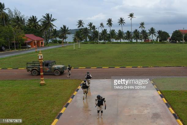 Cambodia naval personnel walk on the ground during a government organised media tour to the Ream naval base in Preah Sihanouk province on July 26,...