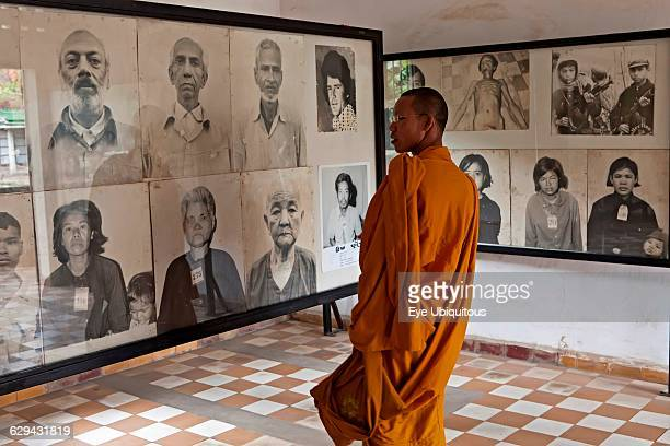 Cambodia Phnom Penh Buddhist monk looking a victims' photos Toul Sleng Genocide Museum S21 Toul Sleng was a high school taken over by the Khmer Rouge...