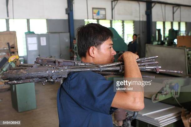 the technical department of the Don Bosco school works machine guns to chairs benches tables after the demobilization