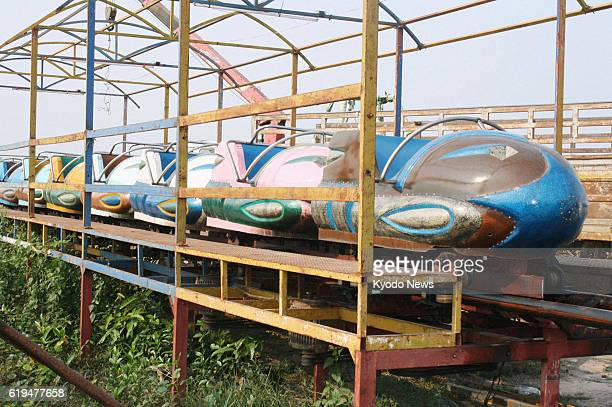 PENH Cambodia Photo taken March 23 shows a roller coaster that derailed at an amusement park in Siem Reap Province Cambodia the previous night...