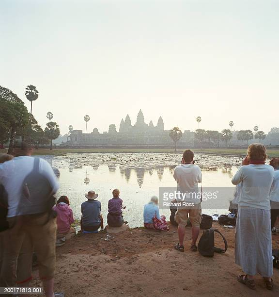 cambodia, siem reap, angkor wat, tourists watching sunrise - angkor wat stock pictures, royalty-free photos & images