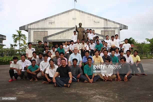 KHM Cambodia Sihanoukville John Visser leader of the Don Bosco Mission with teachers of the Don Bosco Technical School