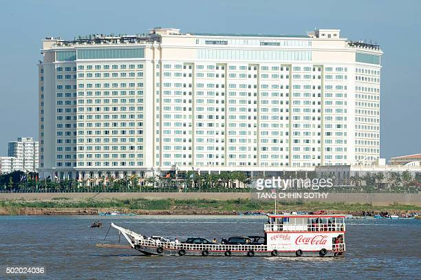 CambodiaeconomyarchitectureFEATURE by Suy Se This photo taken on December 17 2015 shows a ferry sailing past the fivestar Sokha hotel in Phnom Penh...