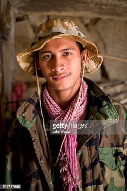 cambodial soldier inside bunker, preah vihear temple, cambodia - jake warga stock pictures, royalty-free photos & images