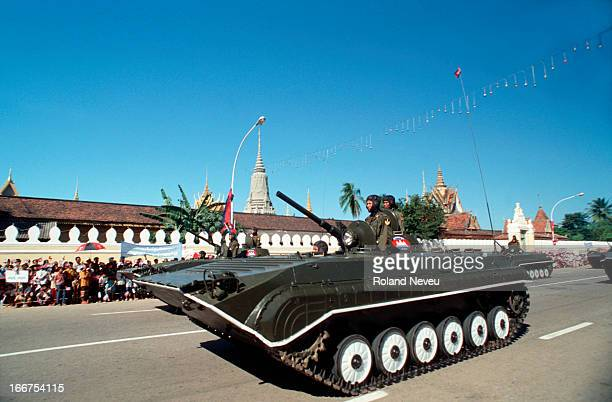 Cambodian army tank rolls past the Palace in Phnom Penh on the anniversary of Independence