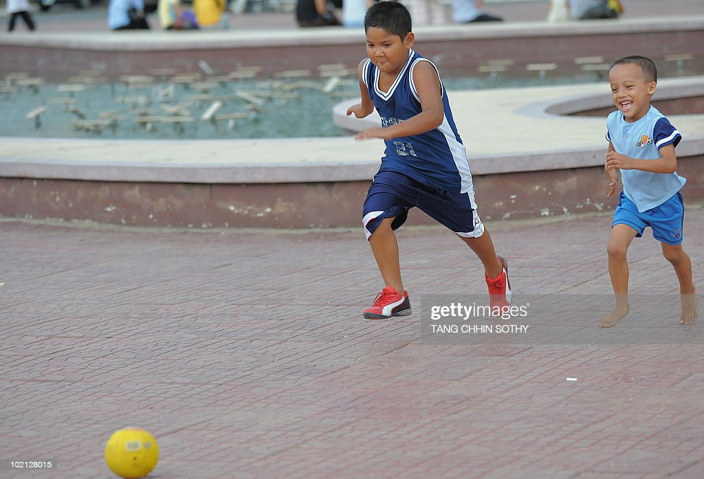 Cambodian boys play football at a park in Phnom Penh on June 15, 2010.