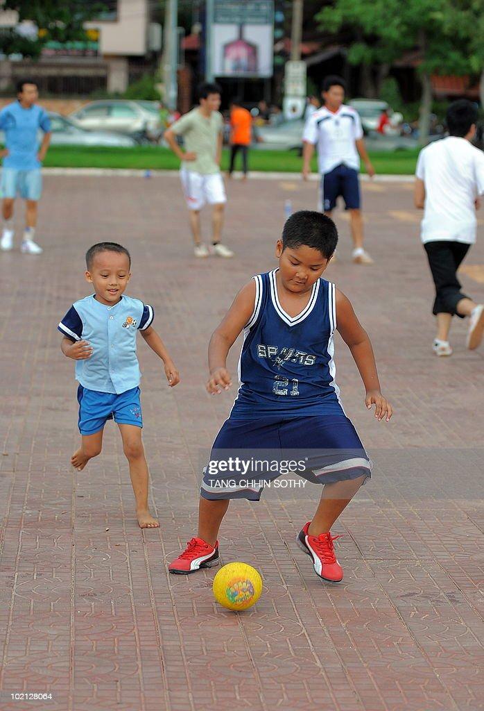 Cambodian boys play football at a park in Phnom Penh on June 15, 2010.